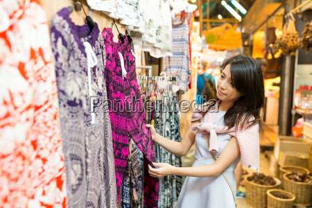 woman shopping at weekend market