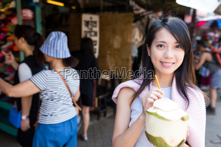 woman enjoy coconut drink in weekend