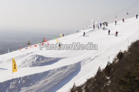 skiers and snowboarders at shijinglong ski