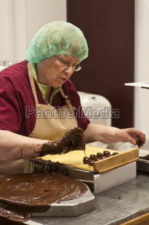 hand decorating chocolates at the ganong