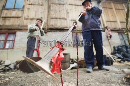 men playing traditional horn instruments at