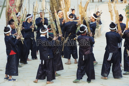 miao ethnic minority group playing traditional