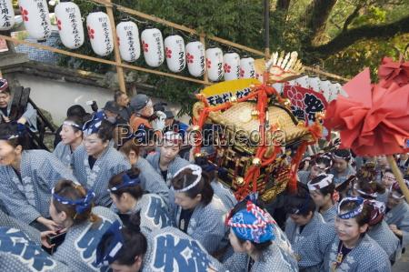 women carrying a mikoshi portable shrine