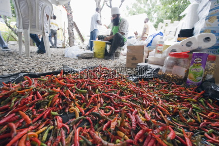 chili peppers being used for cooking