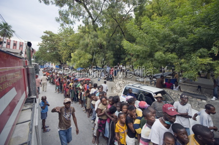 crowds waiting for food distribution after