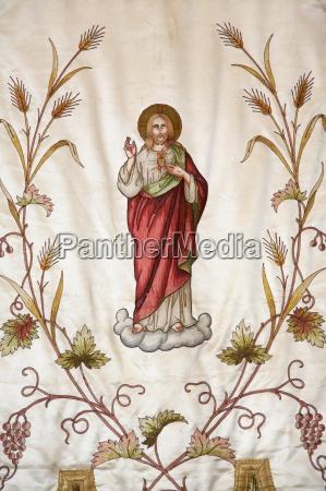 banner depicting jesus in notre dame