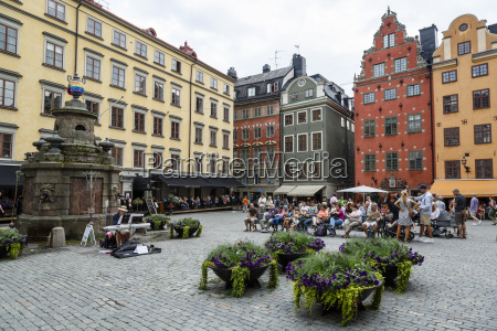 people sitting at stortorget square in