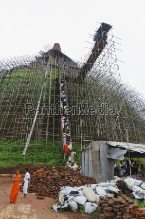 workers and scaffolding on the abhayagiri