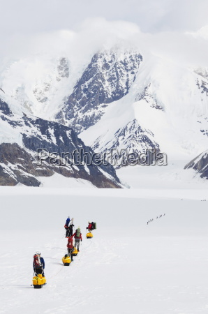 climbing expedition leaving base camp on