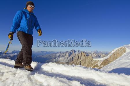 climber on mont blanc chamonix haute