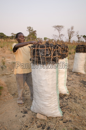 charcoal makers selling charcoal on the