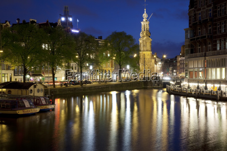 munttoren and canal at dusk amsterdam