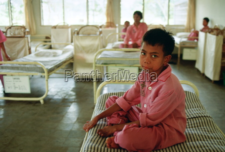 a boy suffering from leprosy is