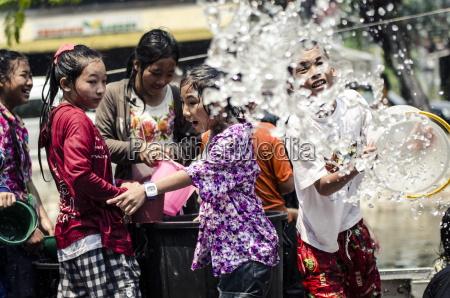 locals celebrate thai new year by