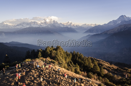 tourists gather on poon hill to