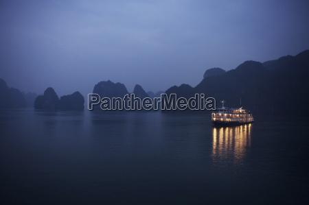 paddle steamer at anchor dawn halong