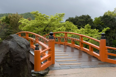 vermilion colored arched bridge at murasaki