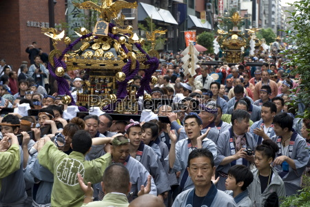 a mikoshi portable shrine being carried