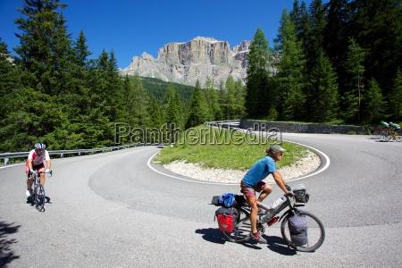 cyclists sella pass trento and bolzano