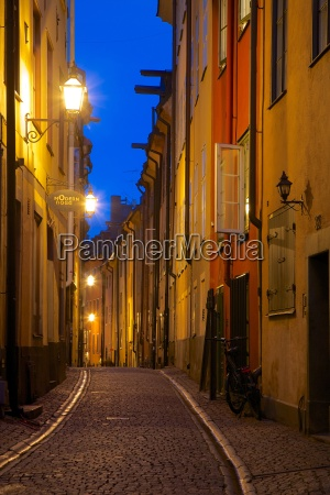 narrow street at dusk gamla stan
