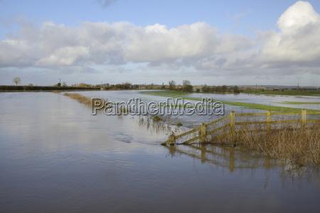 hugely swollen river parrett overflowing onto