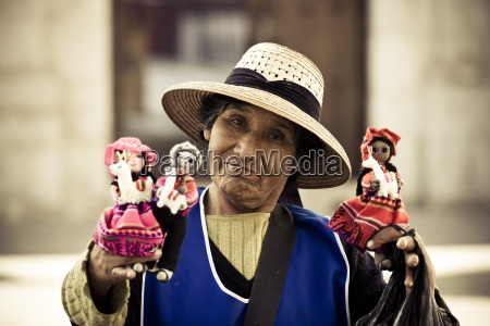 woman selling hand made dolls in