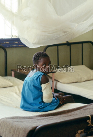 young girl with arm in plaster