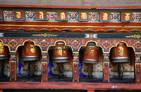 colourful prayer wheels at the kyichu