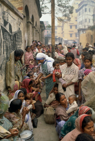 poor women queuing for food at