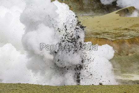 mud being ejected from the caldera