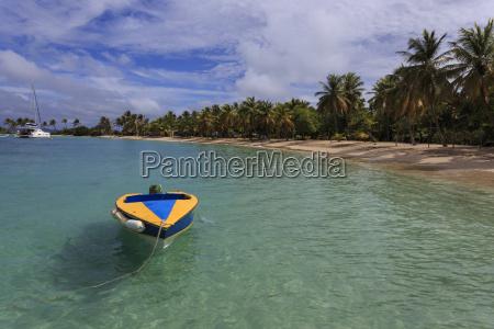 colourful tethered boat near beach saltwhistle