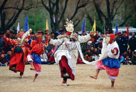 dancers in masks enacting tales of