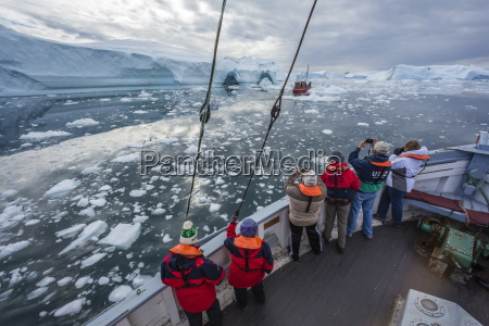a commercial iceberg tour amongst huge