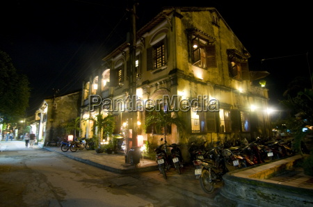 night shot of colonial houses hoi
