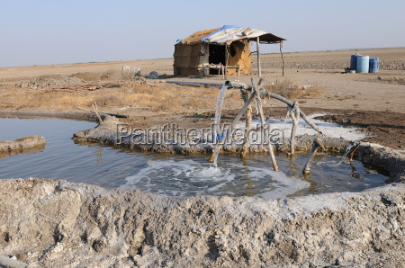 salt making pit and salt workers