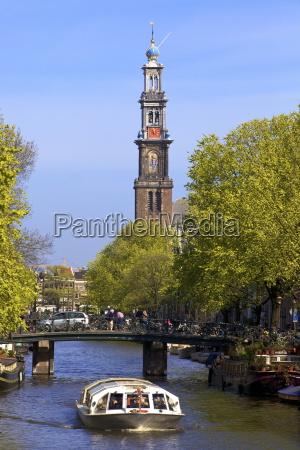 westerkerk tower and prinsengracht canal amsterdam