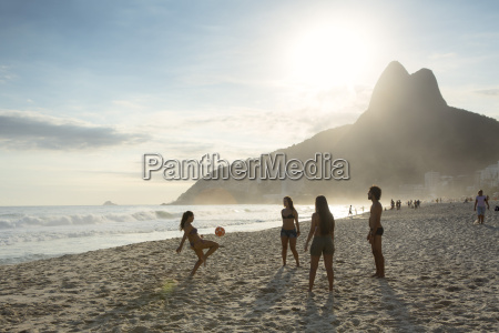 people playing altinha football on ipanema