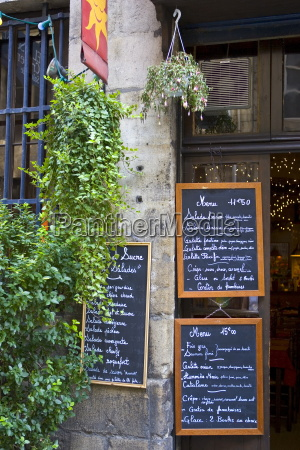 french menus outside cafe restaurant in