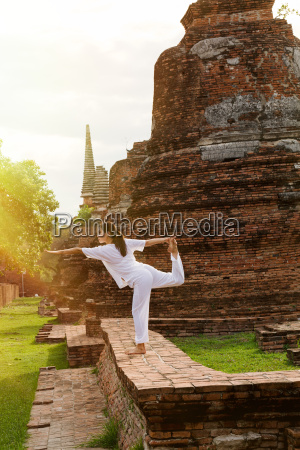 yoga practitioner at a thai temple