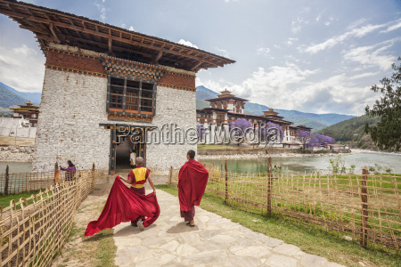 two monks dressed in traditional red
