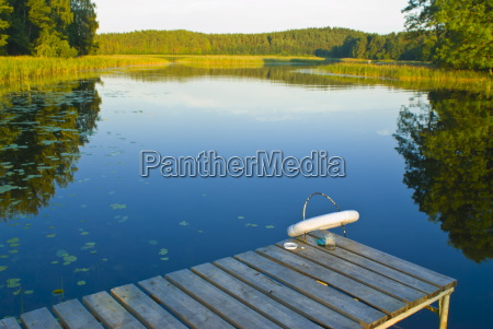 little pier at peaceful lake in