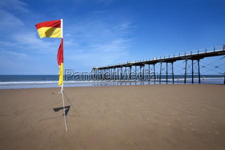 safe bathing flag on the beach