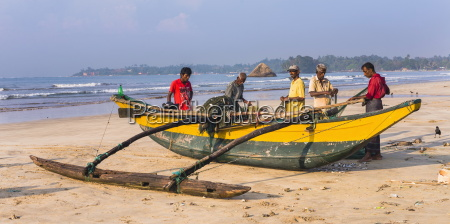 fishermen sorting their catch on weligama