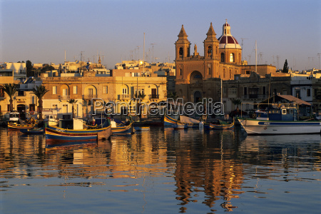harbour with luzzu fishing boats and