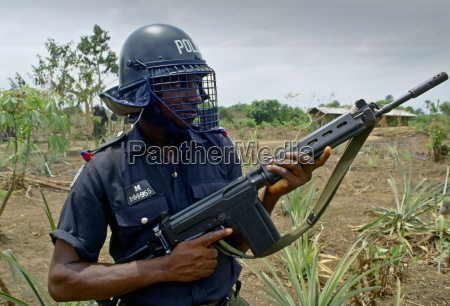 an armed policeman nigeria africa