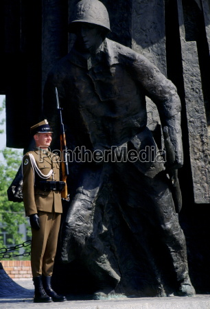 soldier stands at attention with a