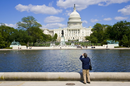 tourist takesphotograph of the united states