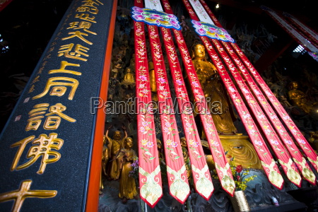 golden buddha and silk banners in