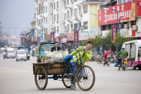 woman with bicycle delivery cart in