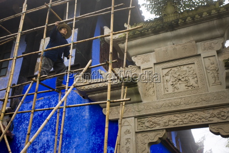 workman carries out restoration repairs at